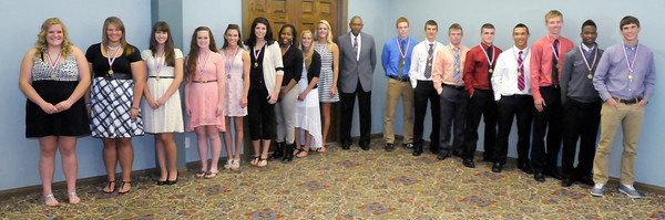 Don Knight | The Herald Bulletin<br /> Elwood's Jessie Noone and Sammy Mireles received the Johnny Wilson Award at the Anderso Country Club on Wednesday. The award recognizes three sport athletes at schools in The Herald Bulletin's coverage area. From left are Kaylee Irwin, Bethani Herniak, Hillary Foreman, Courtney Skinner, Jessie Noone, Rachel Krathwohl, Da'Sha Boyd, Delilah Wright, Mackenzie Boles, Johnny Wilson, Cody Gray, Conner Bates, Drew Johnson, Chandler Hale, Sammy Mireles, Bailey Partington, DaMarcus Watkins and Aaron Patton.