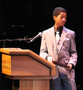 """Levell Hall Jr., a 2014 """"All A's"""" award winner from General Johnnie Wilson, introduces his principal and speaker, Mr. Michael Scott  at the Lorain County Alliance of Black School Educators Inc. 30th Annual Academic Achievement Awards at LCCC. photo by Ray Riedel"""