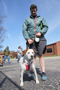 John Sedivec of Grafton with his 3-yr-old dog Summer, a mix of Red Tick Coon Hound and Boxer, at the Love-a-Stray Dog Walk in Avon Lake. He rescued Summer when she was 9 weeks old.  photo by Ray Riedel