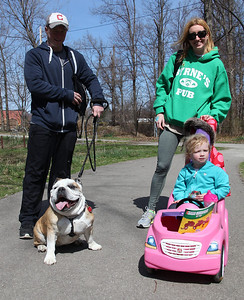"Matt and Lori Jordan of Avon Lake walk with their daughter Ginny, age 3, and their dog ""Adrian"" a 6-yr-old English Bulldog at the Love-a-Stray Dog Walk in Avon Lake. photo by Ray Riedel"