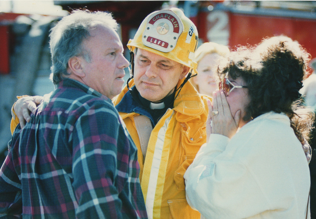 . A Fire Department chaplain informs a couple that their mother has died in the collapse of the Northridge Meadows apartments. The Northridge Earthquake, that at the time was reported to register 6.6 on the richter scale. Greater Northridge, CA. 1/17/1994, photo by (John McCoy/Los Angeles Daily News)