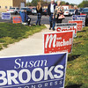 John P. Cleary | The Herald Bulletin<br /> Butch and Betty Land walk past all the campaign signs that line the walkway into the National Guard Armory where they voted in Ward 1, Precinct 1 Tuesday morning.