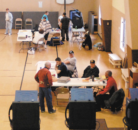 John P. Cleary | The Herald Bulletin<br /> Primary election poll workers spent most of the day just standing around like these folks at Bethany Christian Church in Richland 6 and Union 9, in foreground, as the turnout was slow throughout the county