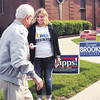 John P. Cleary | The Herald Bulletin<br /> Madison Fowler, a senior at Pendleton Heights High School, passes out literature to one of the few voters that had turned out to vote at ward 1, precinct 6 at East Side Church of God by mid-morning.  The turnout had been very slow to this point.