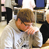 John P. Cleary | The Herald Bulletin<br /> Alex Amick, a senior at Frankton High School working as a clerk in Ward 1, Precinct 7, reads his book to pass time.