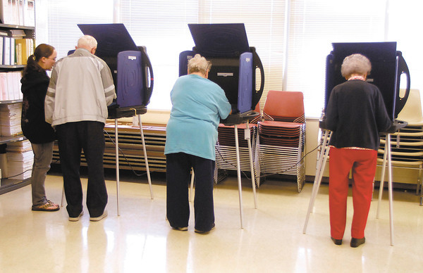 John P. Cleary | The Herald Bulletin<br /> Voters cast their ballots in Ward 1, Precinct 7 for the primary election Tuesday.