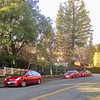 3 red Toyota Priuses parked in a row. Claremont Avenue, Berkeley.