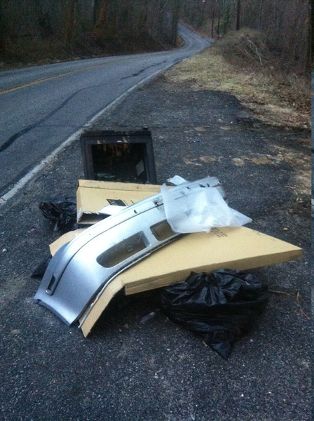 3/12/14: Jon Merryman's cleanup on River Road, A.A. County, Patapsco River watershed. Found a car bumper, a box from a car hood, and a TV (60 lbs).