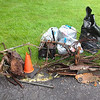 "5/28/14: Caroline Zimmerman's cleanup at the Candlelight Inn parking lot in Catonsville. Sawmill Branch subwatershed. ""Everything to the right of the orange cone was in the stream water or immediately alongside (plastic bottles, aluminum cans, styrofoam, misc). To the left was in the woods. Love the taped, STP bike frame. Had been there a while. A 6-8"" diameter sycamore had grown around a bar of the frame."" <br /> Total scrap metal: exactly 200 lbs (salvage yard total)<br /> Total trash: 100 lbs"