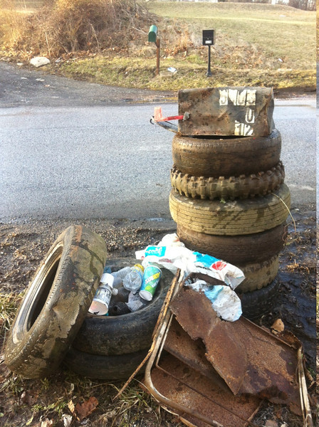 2/7/14: Part of Jon Merryman's cleanup along 5810 Race Road in Howard County. He has found 11 tires; 5 pickup (1 rim), 6 car tires (2 rims), 2 TVs (40 lbs), carpet (25 lbs), mailbox (5 lbs), bottles and cans (25 lbs), and a folded up lawn chair (7 lbs). 94.5 lbs of scrap metal (includes tire rims), 270 lbs for tires and 37.5 lbs for the rest. 402 lbs total.