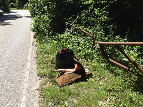6/20/14: Jon Merryman's cleanup on Furnace Avenue at Stoney Run, A.A. County. Found a bag of bottles and cans collected along the roadside, traffic cone and a scrap metal piece (45 lbs).
