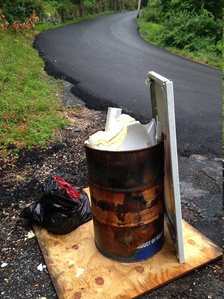 6/13/14: Jon Merryman's cleanup on Hilltop Road in Baltimore County, Patapsco River watershed. Found a metal barrel full of ashes, trash, a piece of plywood, a refrigerator door, and tree limbs. Added with the queen sized mattress and box spring he collected 175 lbs of junk.