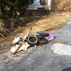 3/14/14: Jon Merryman's cleanup on Hilltop Avenue at the hairpin turn, Balto. Co., Thistle Run subwatershed. Found some lumber, 3 car tires (1 rim), beer bottles and cans, a plastic sandbox, a large canvas cover, and lots more (450 lbs).