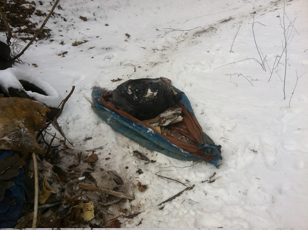 1/26/14: Jon Merryman sleds 6 tarps full of misc. junk from an abandoned lane down to River Road in Balt. Co. Altogether the tarps weighed 1000 lbs!
