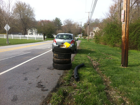 4/18/14: Jon Merryman's cleanup along 7154 Forest Ave., A.A. Co., Deep Run subwatershed. Found four car tires, three on rims. and misc plastic junk in the forest retention area. 125 lbs.