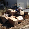 """10/19/14: Jon Merryman's cleanup on Halethorpe Farms Road by the railroad tracks in Baltimore County, Herbert Run subwatershed. Found a pile of several boxes and miscellaneous trash """"probably dumped while the construction was going on at the RR bridge."""" Estimated weight is 150 lbs."""