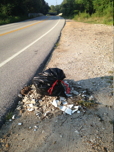 "8/5/14: Jon Merryman's cleanup on Hammonds Ferry Road in Baltimore County, Patapsco River watershed. ""It's not much but people continue to dump here."" Found a bag of garbage from someone in Linthicum Heights and someone's sheetrock and concrete discards. Estimated weight is 40 lbs."