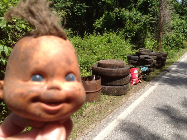 5/25/14: Jon Merryman's cleanup on the top of hill of Furnace Avenue in A.A. County, Deep Run subwatershed. Found 3 tractor trailer tires, 15 pickup tires and 18 car tires, plus a bunch of trash and auto parts. And a baby doll head. 1185 lbs total.