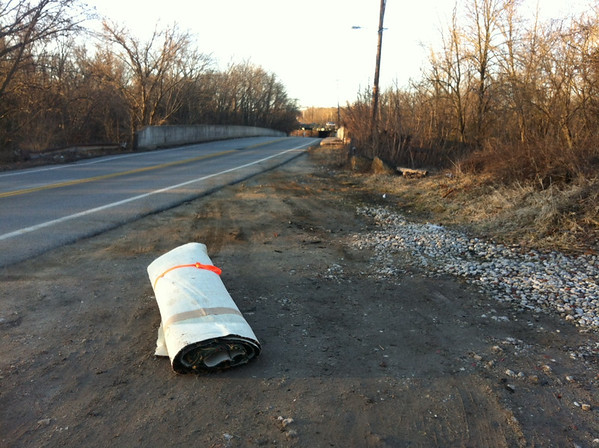 2/24/14: Jon Merryman's cleanup on Hammonds Ferry Road, Baltimore Co., Patapsco River. Found a 300-lb roll of carpet on Hammonds Ferry Rd next to the Patapsco River bridge that someone had dumped the night before.