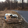 3/14/14: Jon Merryman's cleanup on Hilltop Avenue at the hairpin turn, Baltimore County, Thistle Run subwatershed. Found a pickup bed cover, tire, window frame, lumber, tv, bottles and cans (275 lbs).