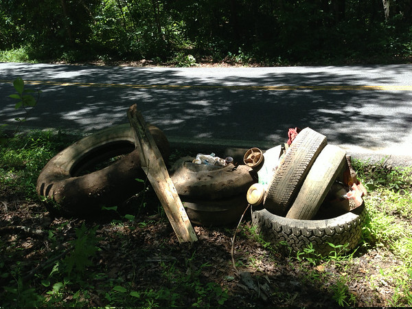 7/5/14: Jon Merryman's cleanup on Ridge Road downhill from the BGE right of way heading toward Furnace Avenue, A.A. County, Deep Run subwatershed. Found a tractor trailer tire, 2 pickup tires, 4 car tires (240 lbs), plastic toys, bucket of bottles and a 4' piece of telephone pole. 275 lbs total.
