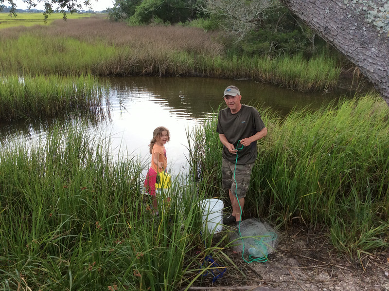 Daddy and his helper catching bait