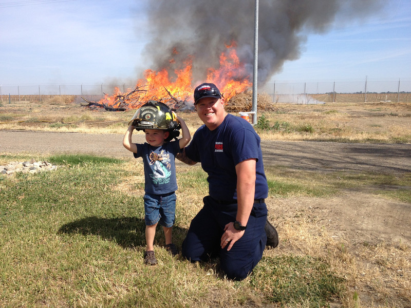 A morning with CJ:  Lemoore NAS fire dept burning a pile of brush.