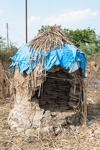 A dung pile used to store dung that is used as fuel at the Dhanore Village.