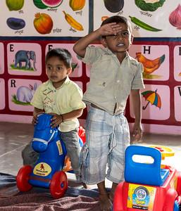 """Children (saluting """"Namaste"""") at the play area in Sherevasti-Anganwadi."""
