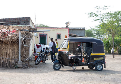 A motorized rickshaw parked in the Dhanore Village.