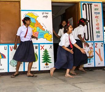 Children break for recess at the Education Support Center in Darekarwadi.