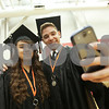 Danielle Guerra - dguerra@shawmedia.com<br /> Friends Saavana Robles and Spencer Zick take a selfie before the start of the 2014 DeKalb High School commencement ceremony at the NIU Convocation Center on Saturday, June 7, 2014.