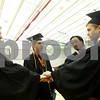 "Danielle Guerra - dguerra@shawmedia.com<br /> Friends Augi Jesmer, Will Ferguson, Josh Sneed, and Drew Seneczko have a ""lost boys"" chant before starting their graduation ceremony at the NIU Convocation Center on Saturday, June 7, 2014."
