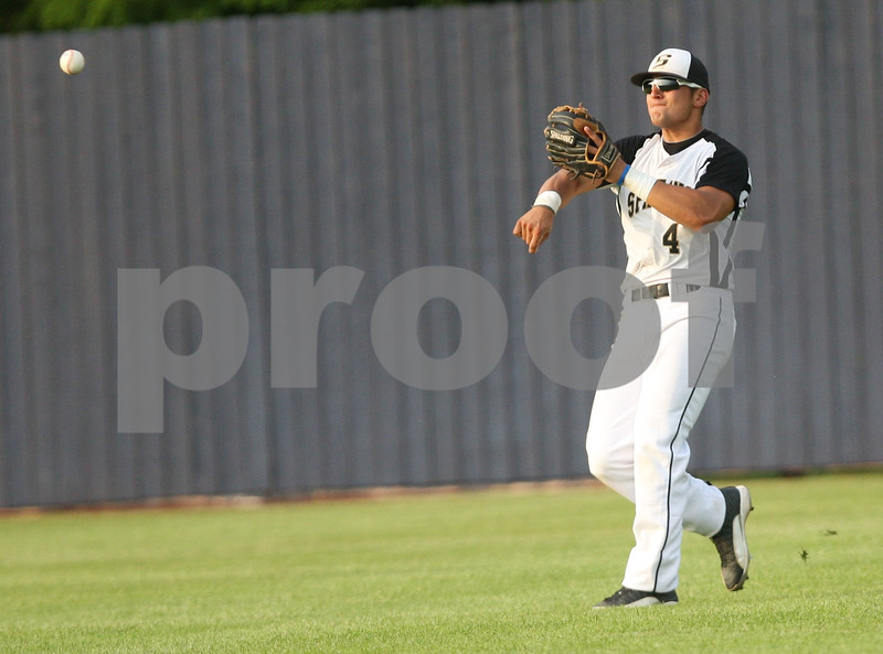 Monica Maschak - mmaschak@shawmedia.com<br /> Sycamore's Alec Kozak makes a play from the outfield in the fifth inning of the class 3A Augustana College Super-Sectional against Metamora in Moline on Monday, June 9, 2014. Sycamore was shut out 10-0 in six innings.