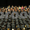 Danielle Guerra - dguerra@shawmedia.com<br /> The DeKalb High School Choir sings in front of the graduates of the Class of 2014 on Saturday, June 7, 2014 at the NIU Convocation Center.