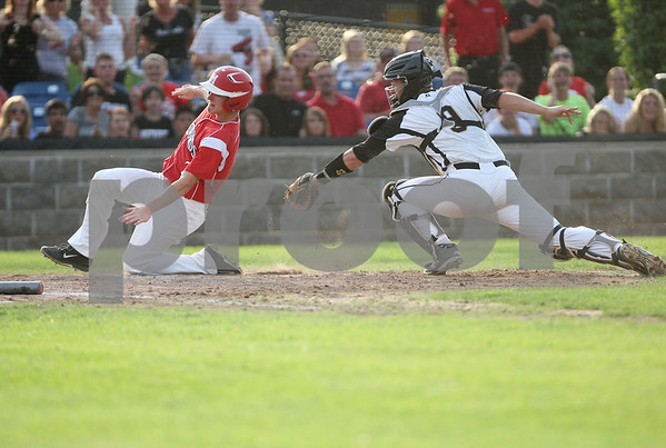 Monica Maschak - mmaschak@shawmedia.com<br /> Sycamore's Nate Haacker just misses Metamora's Brady Fairfield sliding into home in the fourth inning of the class 3A Augustana College Super-Sectional in Moline on Monday, June 9, 2014. Sycamore was shut out 10-0 in six innings.