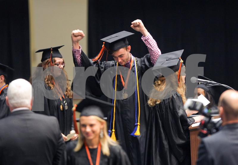 Danielle Guerra - dguerra@shawmedia.com<br /> DeKalb graduate and 2014 Mr. DHS winner Will Ferguson celebrates before receiving his diploma onstage at the NIU Convocation Center on Saturday, June 7, 2014.