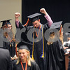 Danielle Guerra - dguerra@shawmedia.com<br /> DeKalb graduate and 2014 Mr. DHS winner Will Ferguson celebrates before receiving his diploma onstage at the NIU Convocation Center on Saturday, June 7, 2014.