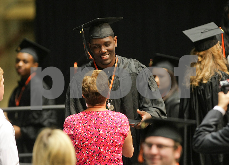 Danielle Guerra - dguerra@shawmedia.com<br /> DeKalb graduate Jonathon Bell receives his diploma during DeKalb's commencement ceremony at the NIU Convocation Center on Saturday, June 7, 2014.  Bell received a heart transplant when he was 12 and has become a subject of a documentary for the Gift of Hope organization.