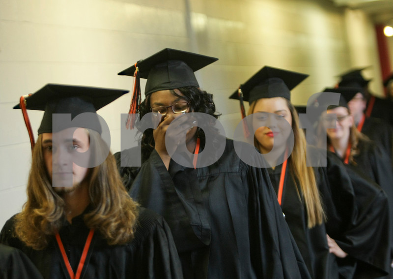 Danielle Guerra - dguerra@shawmedia.com<br /> DeKalb's Jade Barber is overwhelmed while walking down the hallway towards the commencement ceremony at NIU Convocation Center on Saturday, June 7, 2014.