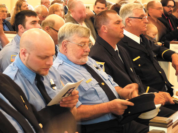 Debbie Wachter/NEWS<br /> Union Township firefighters sit in solemn contemplation before a memorial service for their fallen brother, former chief Jack Stoner.