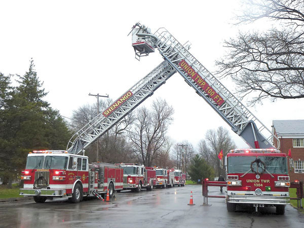 Debbie Wachter/NEWS<br /> The crossed ladders on fire trucks signify the passing of a firefighter. This tribute outside of Northminster Church is for Jack Stoner, who served more than 50 years with the Union Township Volunteer Fire Department. Stoner, a former fire chief, died earlier this week.