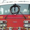 Debbie Wachter/NEWS<br /> A black wreath hangs on the front of a Union Township fire truck as a tribute to Jack Stoner. In the driver's seat is Stoner's retired chief's hat.