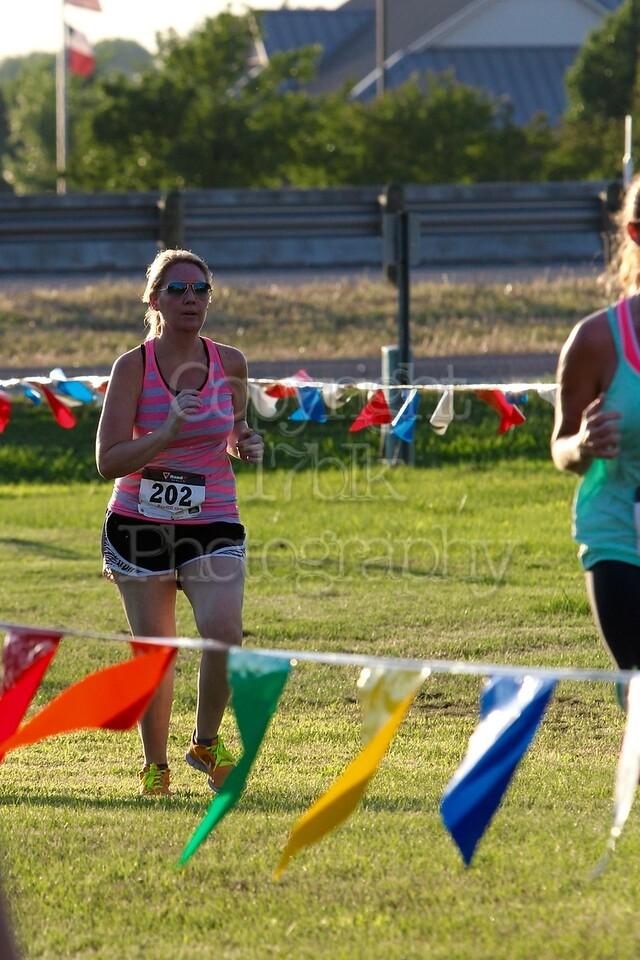 Monica Ames running the 5K Milk Run, headed toward the finish line.