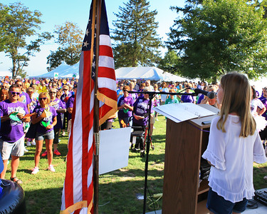 Laney Powers, a 7th grader at the Rising Tide Charter School sings the National Anthem at the 2015 Walk to End Alzheimer's event.