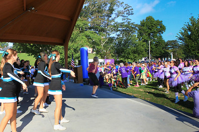 Debbie Rafferty, center, along with the PSHS cheerleaders lead the walkers in warm up walkers with some dancing.