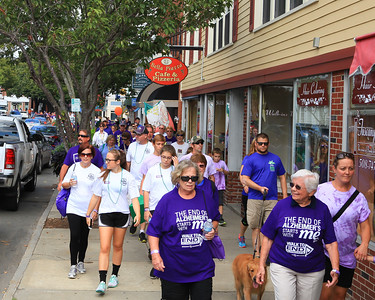 Walk to End Alzheimer's walkers fill the sidewalks of downtown Plymouth on Saturday morning.
