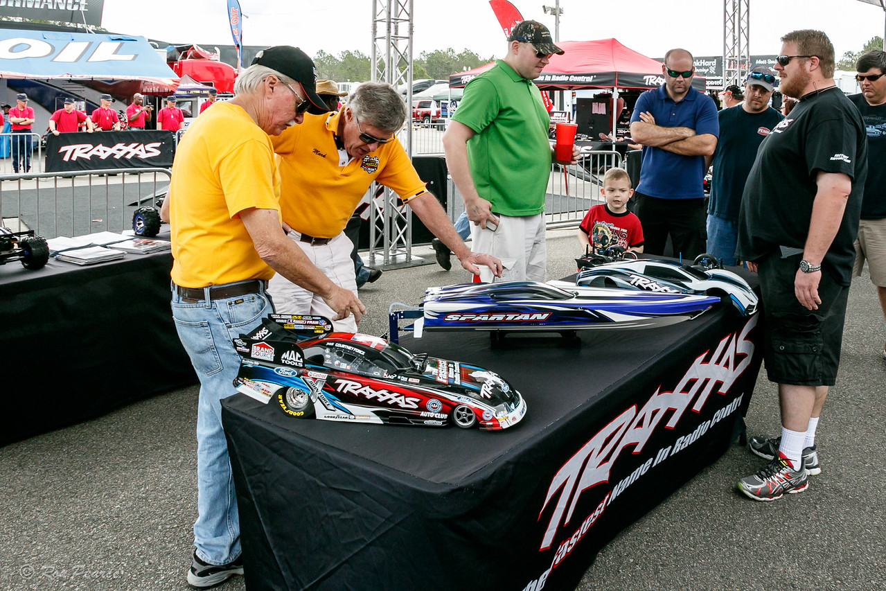 A couple of the Villages Racing Fan Club members in the yellow shirts, debating the finer points of the scale RC Traxxas funny car.