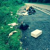 7/27/2015, Jon Merryman, River Road in A.A. county, regrouped 5 bags of  trash, scrap wood, bra and other trash estimating weight of 125 pounds.