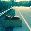 9/8/2015 Jon Merryman, Stoney Run Watershed, AA county Hanover MD,  Ridge Road overpass at MD  295, Desk dumped behind the guardrail. Stacked up and disassembled for pickup.  Estimated weight 100 pounds.